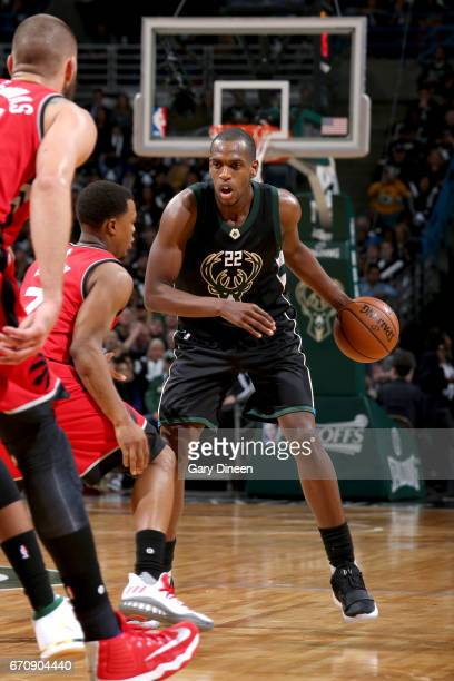 Khris Middleton of the Milwaukee Bucks handles the ball against the Toronto Raptors during Game Three of the Eastern Conference Quarterfinals of the...