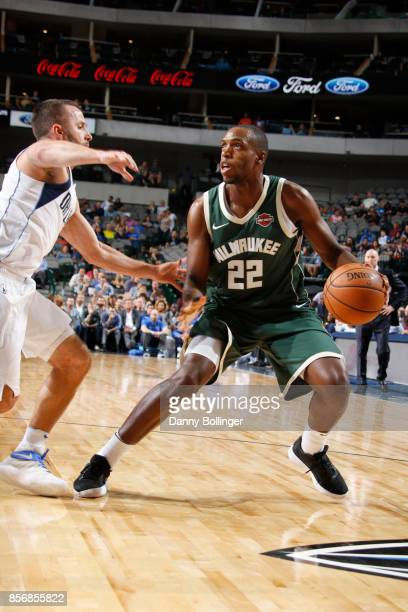 Khris Middleton of the Milwaukee Bucks handles the ball against the Dallas Mavericks during the preseason game on October 2 2017 at the American...