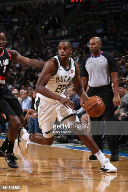 Khris Middleton of the Milwaukee Bucks handles the ball against the Portland Trail Blazers on October 21 2017 at the BMO Harris Bradley Center in...