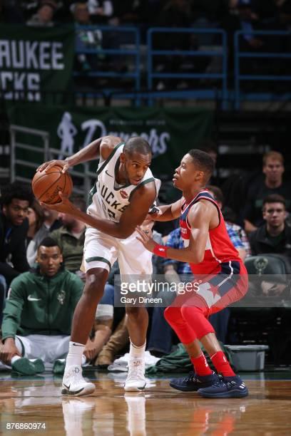 Khris Middleton of the Milwaukee Bucks handles the ball against Tim Frazier of the Washington Wizards on November 20 2017 at the BMO Harris Bradley...