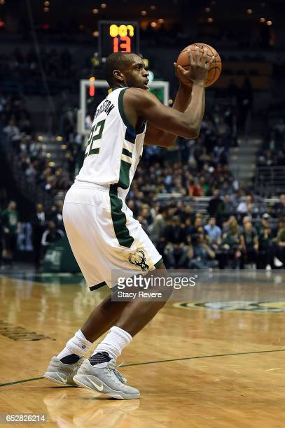 Khris Middleton of the Milwaukee Bucks handles the ball during a game against the Minnesota Timberwolves at the BMO Harris Bradley Center on March 11...