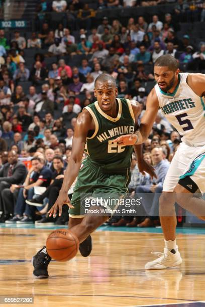 Khris Middleton of the Milwaukee Bucks handles the ball during a game against the Charlotte Hornets on March 28 2017 at the Spectrum Center in...
