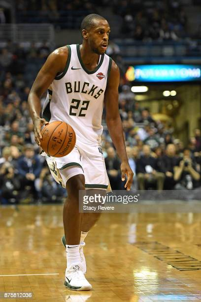 Khris Middleton of the Milwaukee Bucks handles the ball during a game against the Detroit Pistons at the Bradley Center on November 15 2017 in...