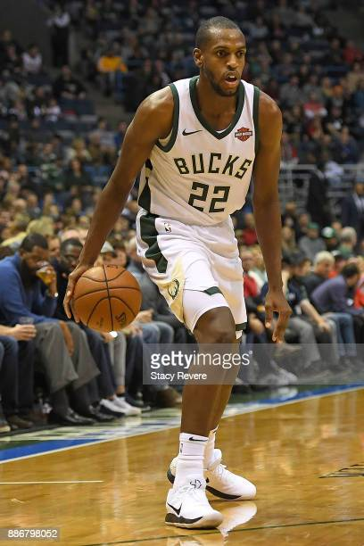 Khris Middleton of the Milwaukee Bucks handles the ball during a game against the Sacramento Kings at the Bradley Center on December 2 2017 in...