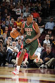 Khris Middleton of the Milwaukee Bucks handles the ball during the game against the Cleveland Cavaliers at The Quicken Loans Arena on October 14 2014...