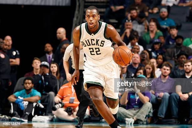 Khris Middleton of the Milwaukee Bucks handles the ball during the game against the Charlotte Hornets on November 29 2015 at Time Warner Cable Arena...