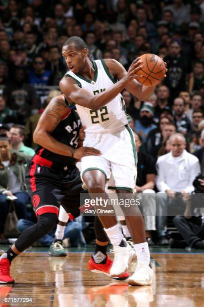 Khris Middleton of the Milwaukee Bucks handles the ball during the game against the Toronto Raptors in Game Four during the Eastern Conference...
