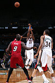 Khris Middleton of the Milwaukee Bucks hits the game winning shot against the Miami Heat on March 24 2015 at BMO Harris Bradley Center in Milwaukee...