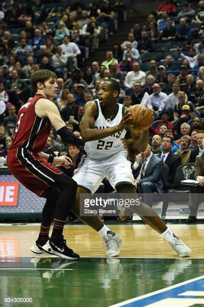Khris Middleton of the Milwaukee Bucks is defended by Luke Babbitt of the Miami Heat during the first half of a game at the BMO Harris Bradley Center...