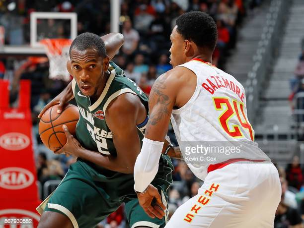 Khris Middleton of the Milwaukee Bucks looks to drive against Kent Bazemore of the Atlanta Hawks at Philips Arena on October 29 2017 in Atlanta...