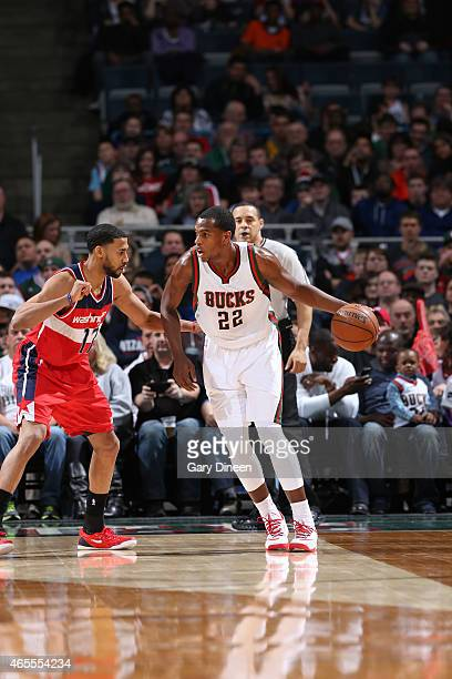 Khris Middleton of the Milwaukee Bucks looks to move the ball against the Washington Wizards during the game on March 7 2015 at BMO Harris Bradley...