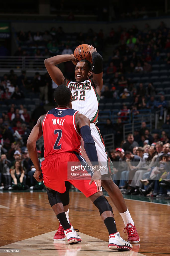 Khris Middleton #22 of the Milwaukee Bucks looks to pass the ball against the Washington Wizards on March 8, 2014 at the BMO Harris Bradley Center in Milwaukee, Wisconsin.