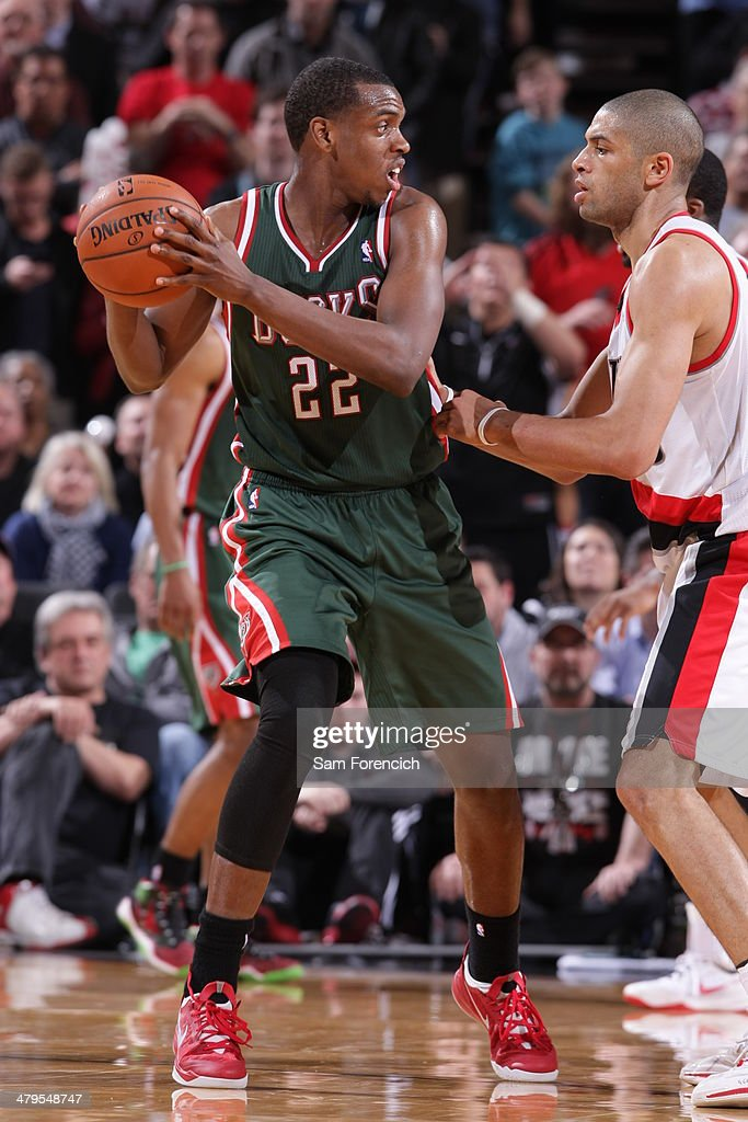 Khris Middleton #22 of the Milwaukee Bucks looks to pass the ball against the Portland Trail Blazers on March 18, 2014 at the Moda Center Arena in Portland, Oregon.
