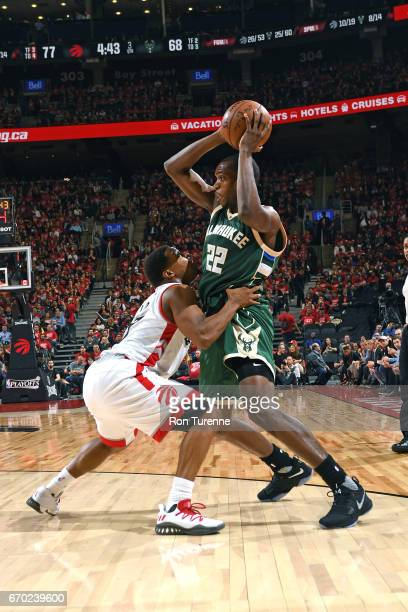 Khris Middleton of the Milwaukee Bucks looks to pass the ball against the Toronto Raptors during Game Two of the Eastern Conference Quarterfinals of...