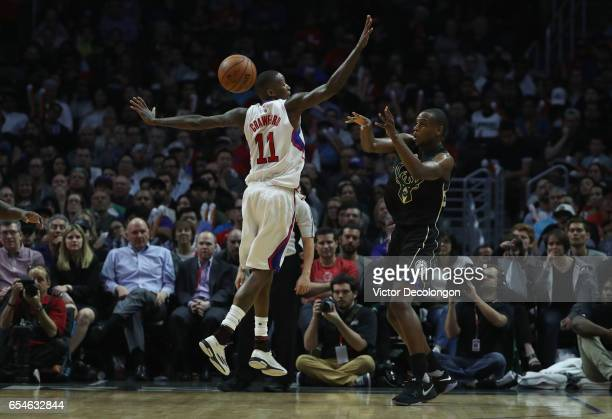 Khris Middleton of the Milwaukee Bucks makes a pass around Jamal Crawford of the Los Angeles Clippers during the second half of the NBA game at...