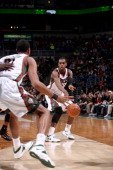 Khris Middleton of the Milwaukee Bucks passes against the Indiana Pacers on February 22 2014 at the BMO Harris Bradley Center in Milwaukee Wisconsin...