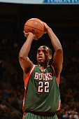 Khris Middleton of the Milwaukee Bucks prepares to shoot a free throw against the Toronto Raptors on February 2 2015 at the Air Canada Centre in...