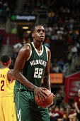 Khris Middleton of the Milwaukee Bucks prepares to shoot a free throw against the Cleveland Cavaliers on October 13 2015 at Quicken Loans Arena in...