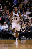 Khris Middleton of the Milwaukee Bucks reacts after shooting a three pointer during the third quarter against the Orlando Magic during the third...
