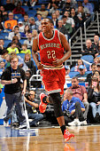 Khris Middleton of the Milwaukee Bucks runs up the court during the game against the Orlando Magic on January 29 2015 at Amway Center in Orlando...