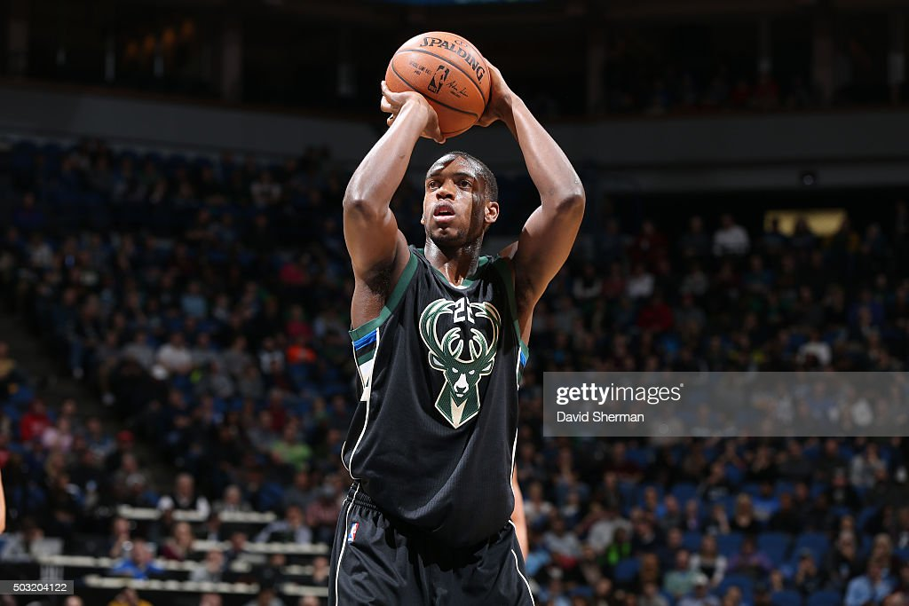 Khris Middleton of the Milwaukee Bucks shoots a free throw against the Minnesota Timberwolves on January 2 2016 at Target Center in Minneapolis...
