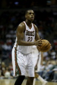 Khris Middleton of the Milwaukee Bucks shoots a free throw during the second half of play against the Toronto Raptors at Bradley Center on November 2...