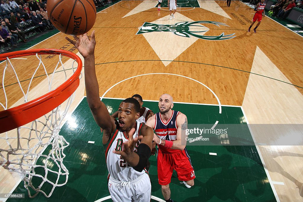Khris Middleton #22 of the Milwaukee Bucks shoots against Marcin Gortat #4 of the Washington Wizards on March 8, 2014 at the BMO Harris Bradley Center in Milwaukee, Wisconsin.
