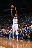 Khris Middleton of the Milwaukee Bucks shoots against the Brooklyn Nets during the game on April 12 2015 at BMO Harris Bradley Center in Milwaukee...