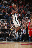 Khris Middleton of the Milwaukee Bucks shoots against the Chicago Bulls during the game on March 7 2016 at United Center in Chicago Illinois NOTE TO...