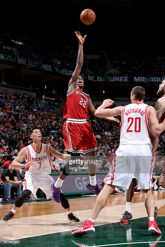 Khris Middleton #22 of the Milwaukee Bucks shoots against the Houston Rockets on February 8, 2014 at the BMO Harris Bradley Center in Milwaukee, Wisconsin.