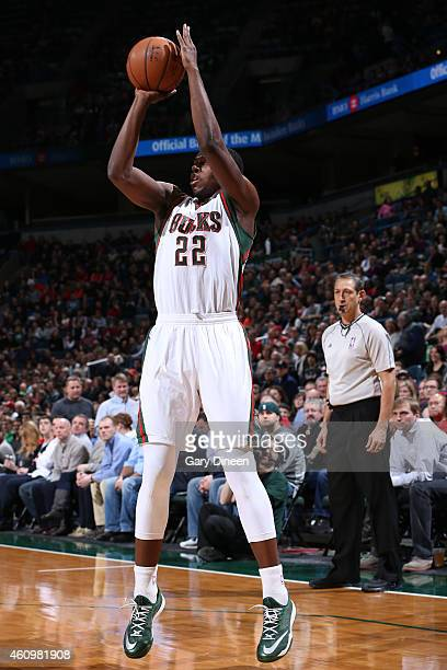 Khris Middleton of the Milwaukee Bucks shoots against the Indiana Pacers on January 2 2015 at the BMO Harris Bradley Center in Milwaukee Wisconsin...