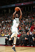 Khris Middleton of the Milwaukee Bucks shoots against the Minnesota Timberwolves on October 20 2015 at the Kohl Center in Madison Wisconsin NOTE TO...