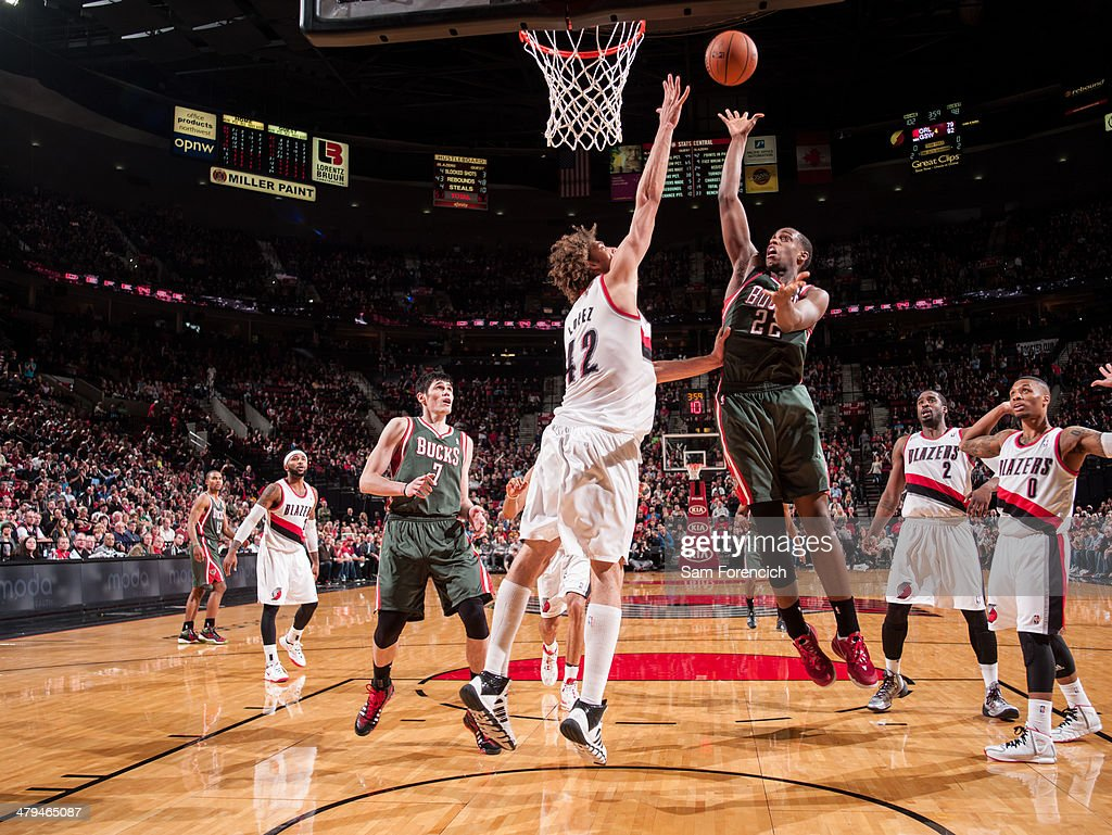 Khris Middleton #22 of the Milwaukee Bucks shoots against the Portland Trail Blazers on March 18, 2014 at the Moda Center Arena in Portland, Oregon.