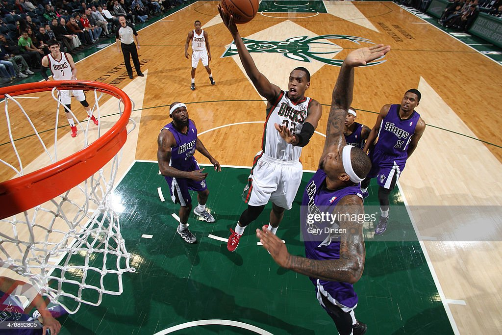 Khris Middleton #22 of the Milwaukee Bucks shoots against the Sacramento Kings on March 5, 2014 at the BMO Harris Bradley Center in Milwaukee, Wisconsin.