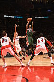 Khris Middleton of the Milwaukee Bucks shoots against the Toronto Raptors on February 2 2015 at the Air Canada Centre in Toronto Ontario Canada NOTE...