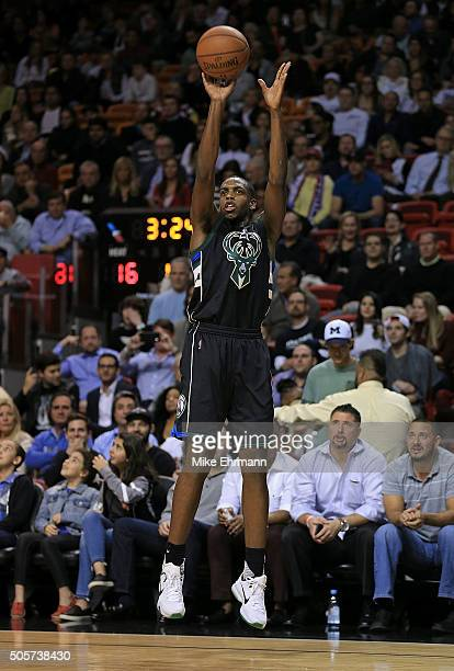 Khris Middleton of the Milwaukee Bucks shoots during a game against the Miami Heat at American Airlines Arena on January 19 2016 in Miami Florida...