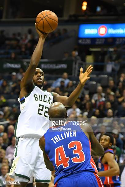 Khris Middleton of the Milwaukee Bucks shoots over Anthony Tolliver of the Detroit Pistons during the first half of a game at the Bradley Center on...