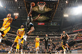 Khris Middleton of the Milwaukee Bucks shoots the ball against the Indiana Pacers on December 31 2015 at Bankers Life Fieldhouse in Indianapolis...
