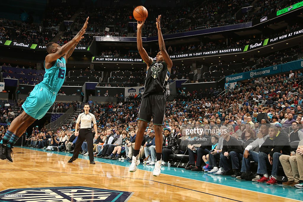 Khris Middleton of the Milwaukee Bucks shoots the ball against the Charlotte Hornets on January 16 2016 at Time Warner Cable Arena in Charlotte North...