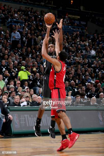 Khris Middleton of the Milwaukee Bucks shoots the ball against the Toronto Raptors during Game Three of the Eastern Conference Quarterfinals of the...