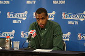 Khris Middleton of the Milwaukee Bucks speaks to the media after Game Two of the Eastern Conference Quarterfinals against the Chicago Bulls during...