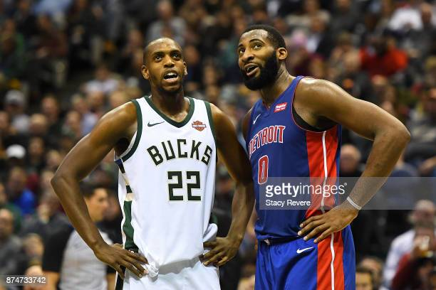 Khris Middleton of the Milwaukee Bucks speaks with Andre Drummond of the Detroit Pistons during the second half of a game at the Bradley Center on...