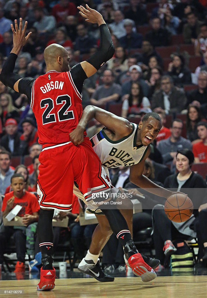 Khris Middleton #22 of the Milwaukee Bucks tries to get around Taj Gibson #22 of the Chicago Bulls at the United Center on March 7, 2016 in Chicago, Illinois.