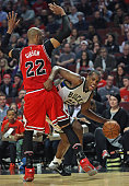 Khris Middleton of the Milwaukee Bucks tries to get around Taj Gibson of the Chicago Bulls at the United Center on March 7 2016 in Chicago Illinois...