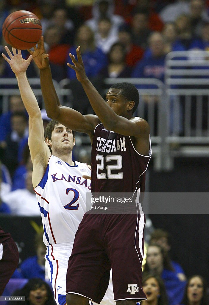 Khris Middleton #22 of the Texas A&M Aggies passes against Conner Teahan #2 of the Kansas Jayhawks during the quarterfinals of the Big 12 Basketball Tournament March 8, 2012 at Sprint Center in Kansas City, Missouri.