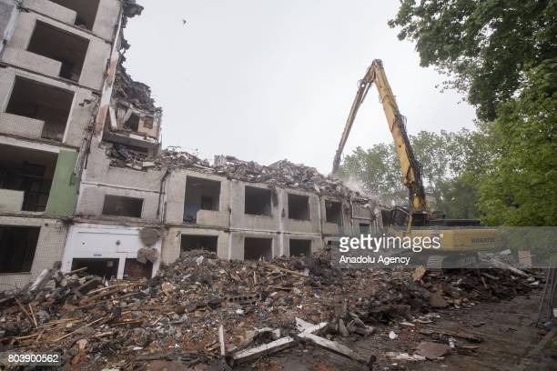 Khrushchevera fivefloor frame houses is being demolished with a construction machine according to the Moscow government's redevelopment plan to tear...