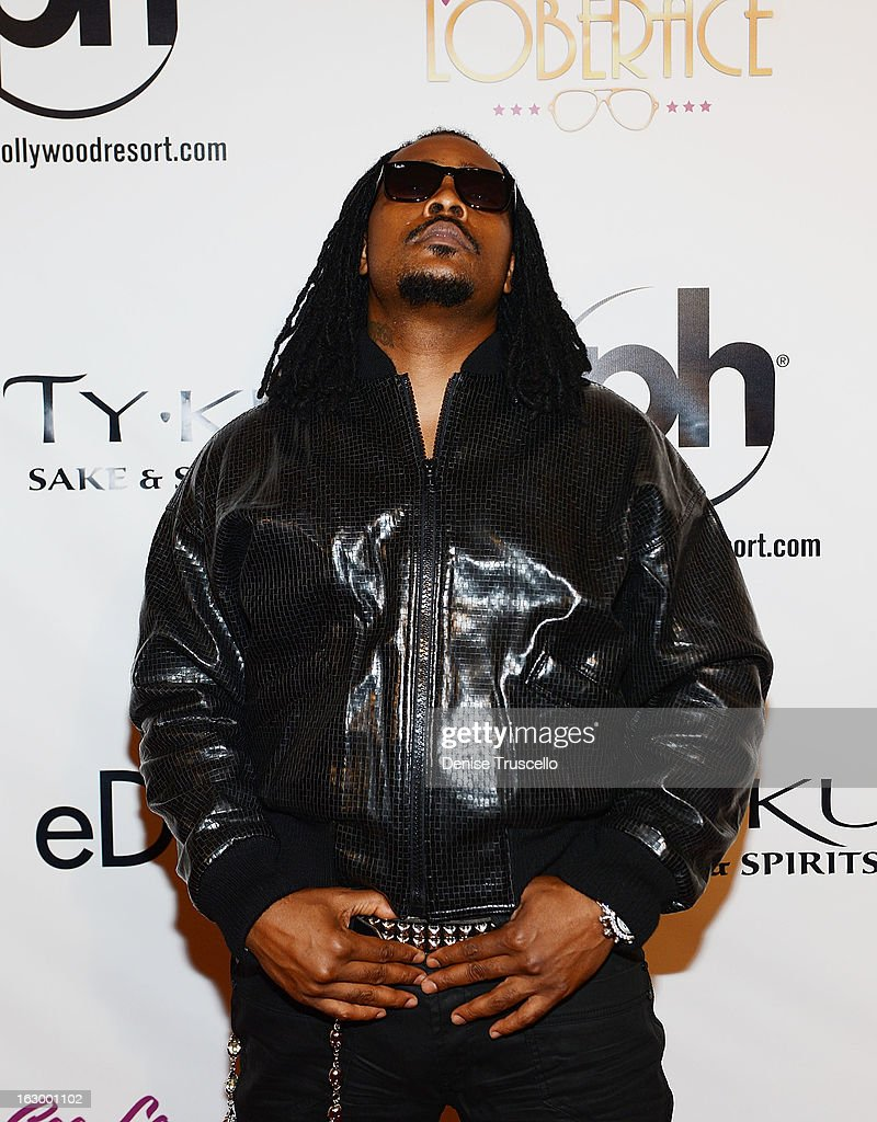 <a gi-track='captionPersonalityLinkClicked' href=/galleries/search?phrase=Khujo&family=editorial&specificpeople=5497891 ng-click='$event.stopPropagation()'>Khujo</a> arrives at the residency debut of 'CeeLo Green is LOBERACE' at Planet Hollywood Resort & Casino on March 2, 2013 in Las Vegas, Nevada.