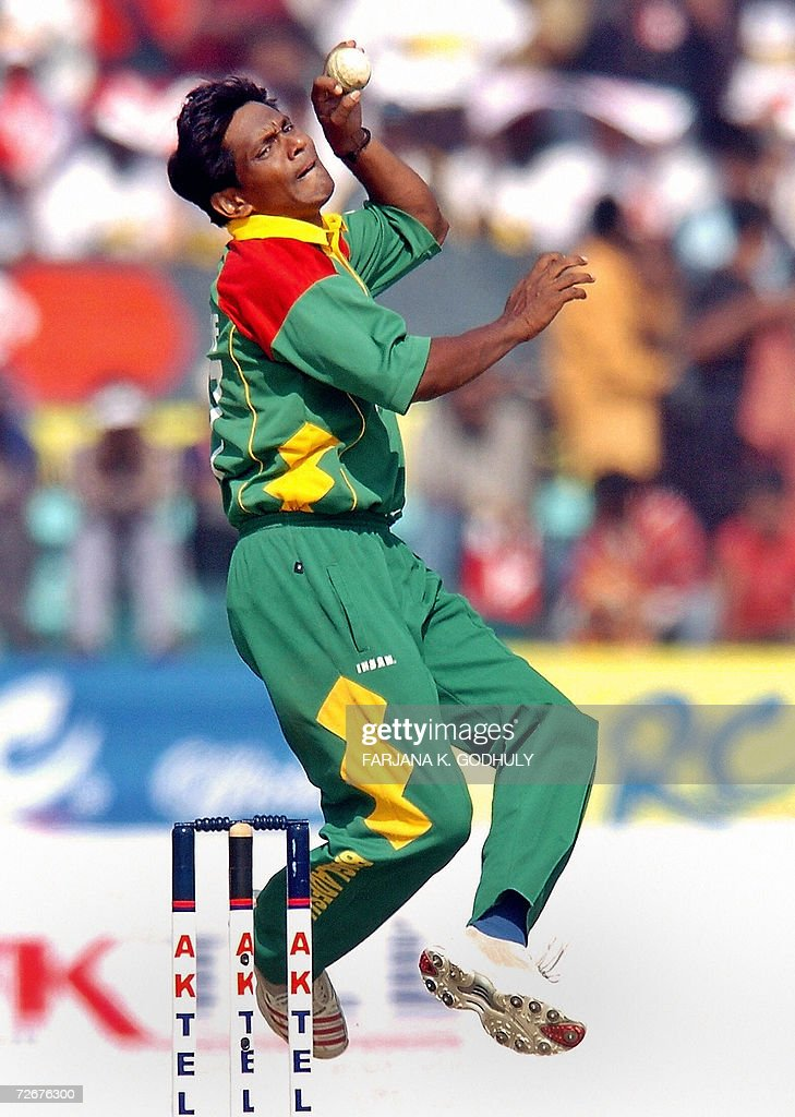 Bangladeshi cricketer Mohammad Rafique delivers a ball to Zimbabwean batsman Brend Taylor during the first OneDay International match between...