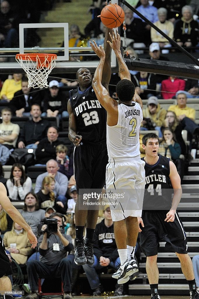 Khyle Marshall #23 of the Butler Bulldogs jumps to block a shot by Kedren Johnson #2 of the Vanderbilt Commodores at Memorial Gym on December 29, 2012 in Nashville, Tennessee.