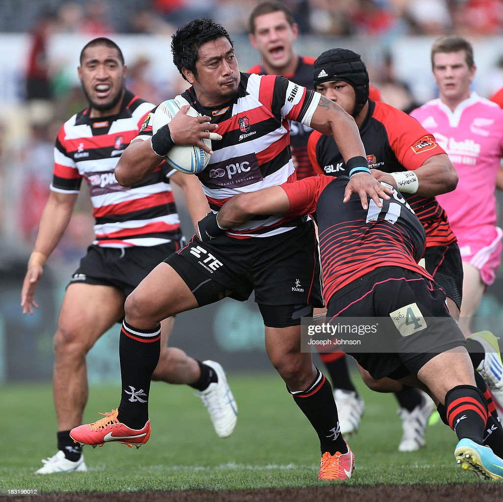 Ki Anufe of Counties Manukau runs with the ball in the tackle of Patrick Osborne during the round eight ITM Cup match between Cantebury and Counties Manukau at AMI Stadium on October 6, 2013 in Christchurch, New Zealand.